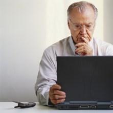 Pensive Businessman Using Laptop